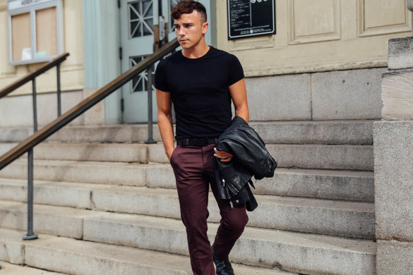 Men's Fashion Travel and Lifestyle Blogger Justin Livingston wears Express Men's Slim Suit and Leather Moto Jacket in New York City